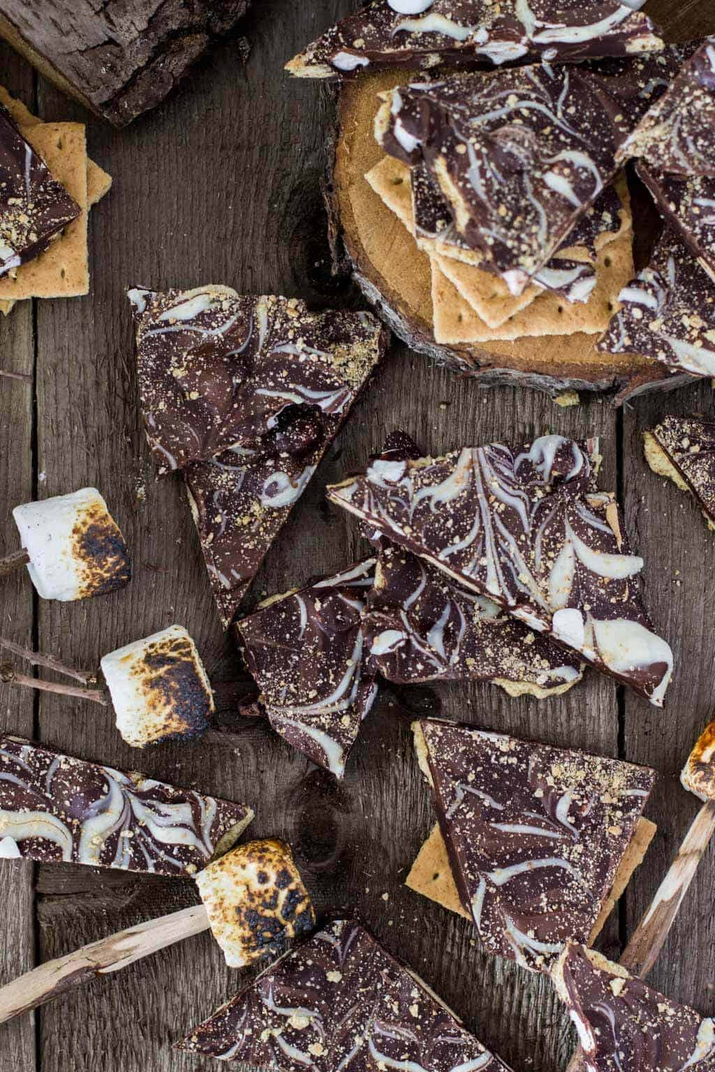 S'mores Bark! Made with dark chocolate and loaded with graham cracker crumbs and mini marshmallows, then swirled with milk chocolate and white chocolate